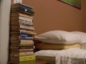If someone offered me a pizza party every Friday, would the stack beside the bed get any smaller??